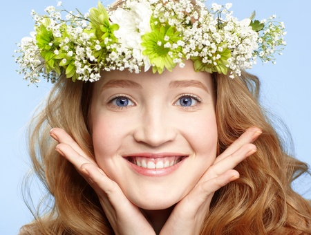 anniversary flower: Happy young blue-eyed girl with flower wreath