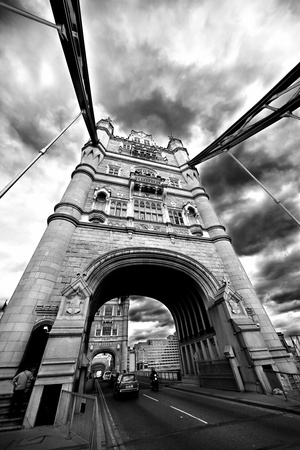 steel arch bridge: Tower Bridge London England with street traffic and people. May 2009 Stock Photo