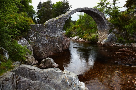 old packhorse bridge: Old stone Packhorse Bridge over the river Dulnain in Carrbridge, Scotland