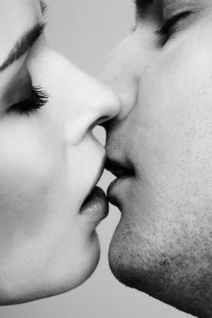 close up portrait of young caucasian couple kissing photo