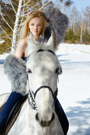 Young blond beautiful woman with light gray horse  photo