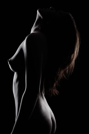 black women naked: woman on black background