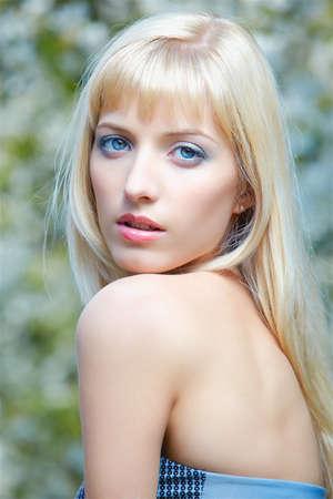 outdoor portrait of beautiful blue-eyed blonde girl posing photo