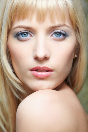 close-up headshot portrait of beautiful blue-eyed blonde girl Stock Photo - 9782199