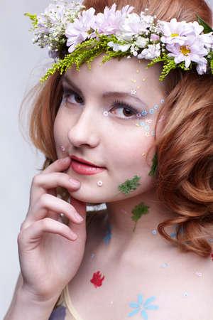 portrait of beautiful slavonic redhead girl in flower garland photo