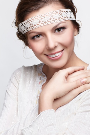 expression portrait of beautiful happy russian blonde folk girl in traditional slavonic embroidered head stripe photo