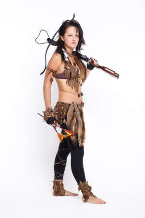full-length portrait of beautiful woman fur hunter with crossbow on gray photo