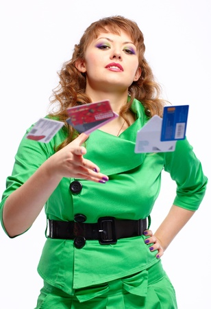portrait of young happy and dreamy shopaholic woman with credit cards photo