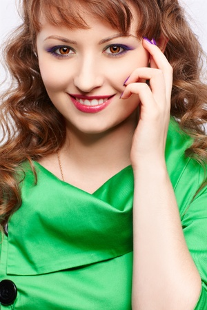 portrait of young beautiful woman in green dress Stock Photo - 10328495