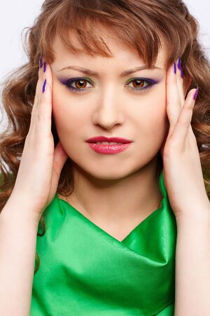 portrait of young beautiful woman in green having symtopms of headache Stock Photo - 10328498