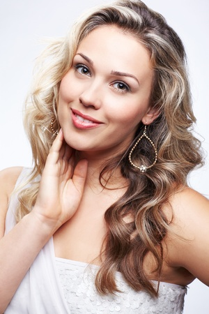 portrait of beautiful plus size curly young blond woman posing on gray Stock Photo - 10479168
