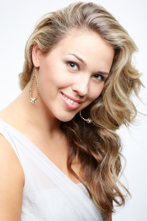 portrait of beautiful plus size curly young blond woman posing on gray Stock Photo - 10479201