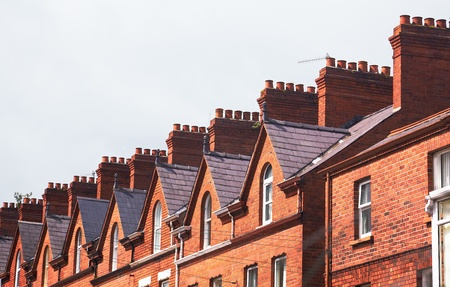 northern ireland: Chimneys on the roof of town house Stock Photo