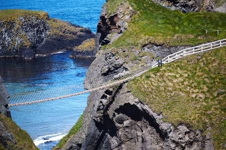 northern ireland: Carrickarade rope bridge from Portaneevy in Northern Ireland Stock Photo
