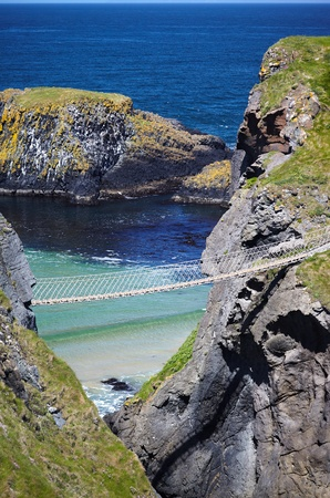 Carrickarade rope bridge from Portaneevy in Northern Ireland Stock Photo - 10591046