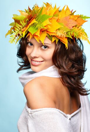 Autumn woman with crown of fall maple leaves photo