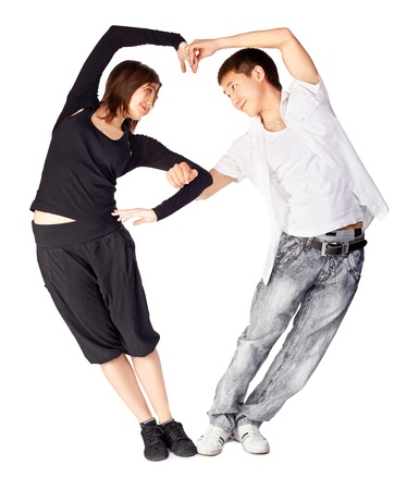 teen dance: isolated portrait of asian guy and european girl dancing hustle standing togeteher in heart shape