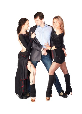 isolated portrait of three hustle dancers, one guy and two girls in black dresses photo