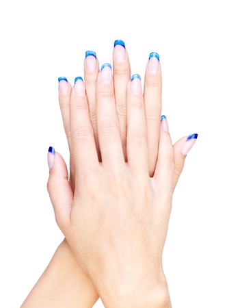 Hands with woman's professional blue french nails manicure isolated on white  Stock Photo - 10810604