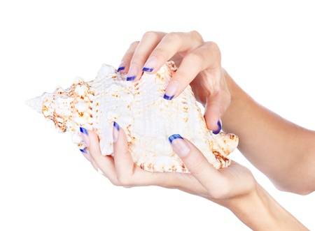 naildesign: isolated body part shot of beautiful healthy young womans manicured hands with shell on white