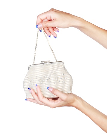 naildesign: isolated body part shot of beautiful young womans manicured hands with fancy clutch on white Stock Photo