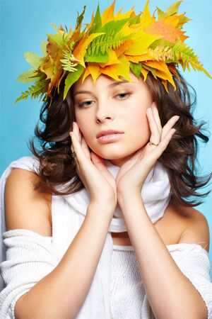 portrait of beautiful young brunette woman in garland of autumn maple and fern leaves Stock Photo - 10944609