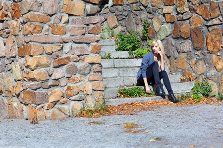 stone steps: Beautiful young girl sitting on stone steps Stock Photo