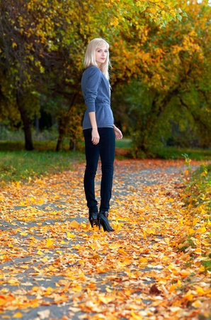 Young beautiful girl walking in autumn park Stock Photo - 11178458