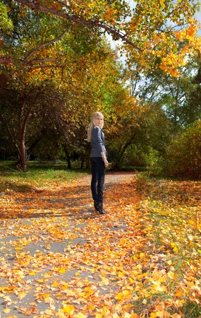 Young beautiful girl walking in autumn park Stock Photo - 11178487