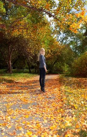 Young beautiful girl walking in autumn park Stock Photo - 11178487