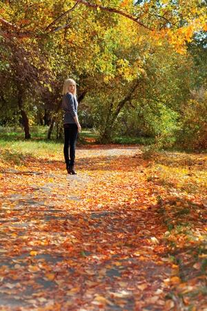 Young beautiful girl walking in autumn park Stock Photo - 11178479