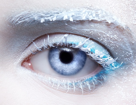 close-up body part portrait of beautiful woman's frozen style eye zone make up photo