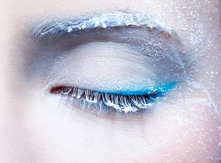 close-up body part portrait of beautiful womans frozen style eye zone make up photo