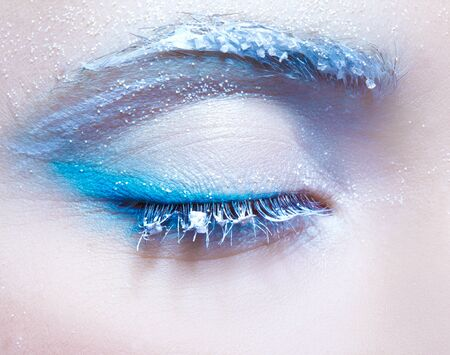 eye's closed: close-up body part portrait of beautiful womans frozen style eye zone make up Stock Photo