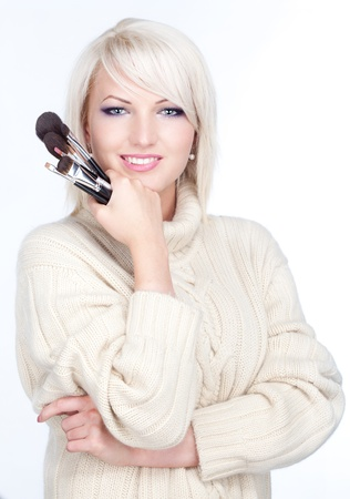 Young woman beauty makeup artist with brushes  photo