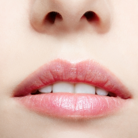 close-up body part portrait of beautiful womans lips zone make up photo