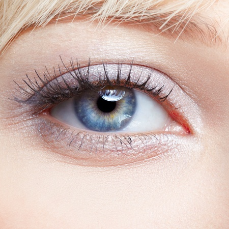 close-up body part portrait of beautiful womans eye make up photo