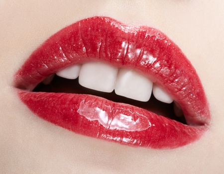 close-up body part portrait of beautiful womans lips bright red make up photo