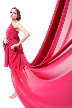 dress: Beautiful woman in red flying dress isolated on white background  Stock Photo