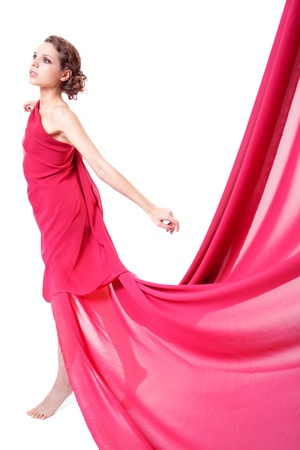 Beautiful woman in red flying dress isolated on white background  photo
