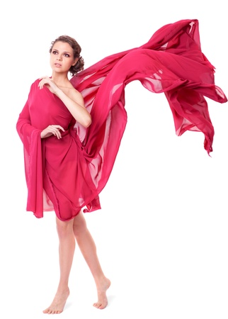 woman flying: Beautiful woman in red flying dress isolated on white background  Stock Photo