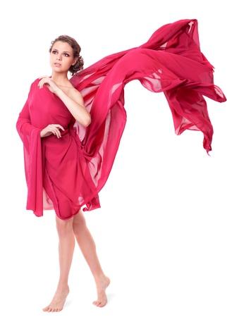donna volante: Bella donna in abito rosso volante isolato su sfondo bianco