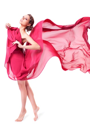 Beautiful woman in red flying dress isolated on white background  Stock Photo