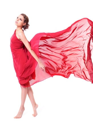dream body: Beautiful woman in red flying dress isolated on white background  Stock Photo