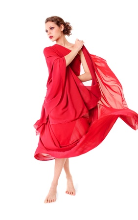 girl in red dress: Beautiful woman in red flying dress isolated on white background  Stock Photo