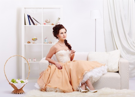 portrait of young beautiful retro woman in skirt with petticoat and corset posing in vintage interior Stock Photo - 12341860