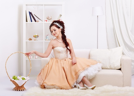 portrait of young beautiful retro woman in skirt with petticoat and corset posing in vintage interior Stock Photo - 12341856