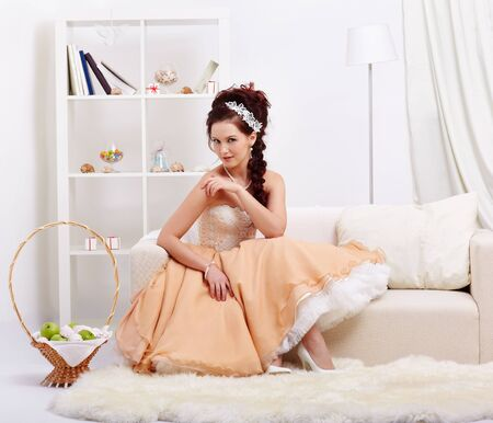 portrait of young beautiful retro woman in skirt with petticoat and corset posing in vintage interior Stock Photo - 12341849