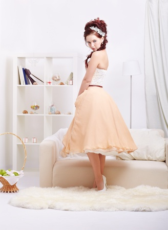 portrait of young beautiful retro woman in skirt with petticoat and corset posing in vintage interior Stock Photo - 12341846