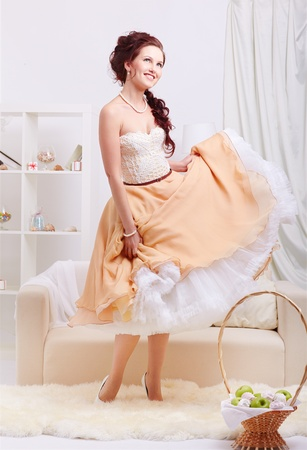 portrait of young beautiful retro woman in vintage skirt with petticoat and corset on gray Stock Photo - 12341828